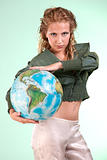 Pretty blonde woman holding globe of world, studio shot