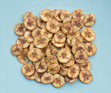 Dried banana slices coated with sugar