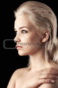 faceshot of a blonde pretty gir on black backgroundl