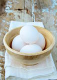 Fresh eggs a wooden bowl, organic food