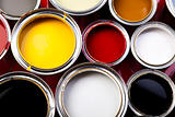 Cans and paint on the colourful background