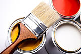 Cans of paint with paintbrush