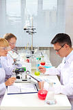 Serious clinicians studying new medicine in laboratory