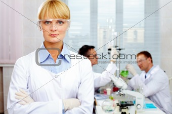 Portrait of a pretty scientist looking at camera