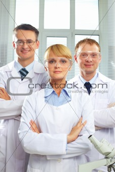 Portrait of three doctors looking at camera and smiling