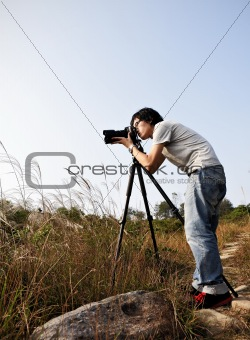 Photographer taking photo at wild