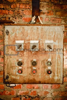 An old rusty control panel on the wall