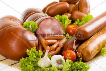 Sausages and ham with lettuce, garlic and tomatoes