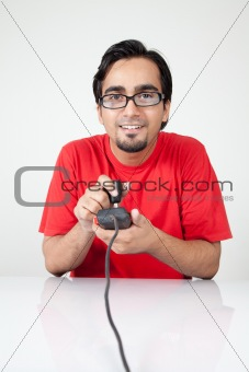 Nerd playing retro video game