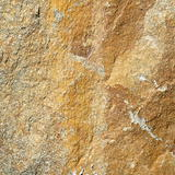 texture of yellow stone,stone wall background