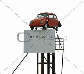 Old car and billboard