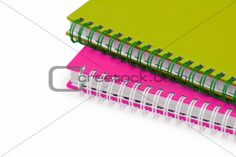 Close up of twol notebooks isolated on white