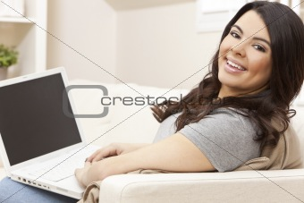 Happy Hispanic Woman Using Laptop Computer at Home