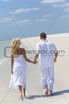 Happy Young Couple Running or Walking Holding Hands on Tropical