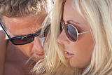 Sexy Attractive Man and Woman Couple Happy In Sunglasses