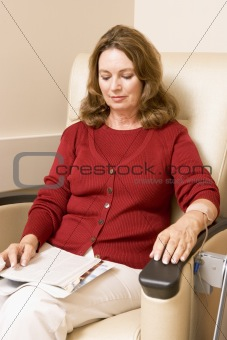 Patient Reading Magazine While Being MonitPatient Reading Magazi