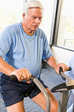 Patient Working Out On Exercise Machine