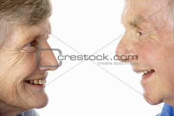 Portrait of senior couple smiling at each other
