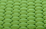 closeup background of green pills