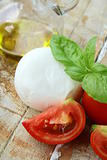 Italian mozzarella cheese with tomato and basil