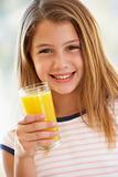 Young Girl Drinking Orange Juice