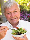 Senior Man Eating Fresh Salad