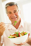 Middle Aged Man Eating A Healthy Salad