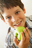 Young Boy Eating Apple