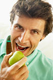 Mid Adult Man Eating A Healthy Apple
