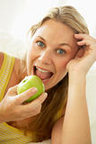Mid Adult Woman Eating A Healthy Apple
