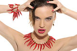 Sexy woman with jewelry of hot pepper