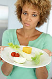 Mid Adult Woman Holding A Plate Of Healthy Food