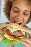 Mid Adult Woman Eating A Burger