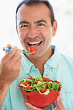 Middle Aged Man Eating A Fresh Green Salad