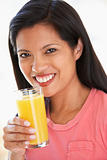Mid Adult Woman Drinking Fresh Orange Juice