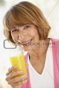 Middle Aged Woman Drinking Fresh Orange Juice