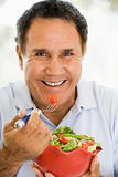 Senior Man Eating A Fresh Green Salad
