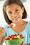 Girl Eating A Bowl Of Fresh Fruit Salad