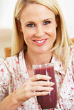 Mid Adult Woman Holding A Fresh Berry Smoothie