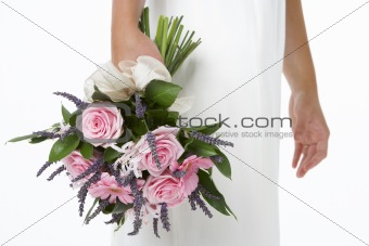 Bride Holding Bouquet Of Pink Flowers