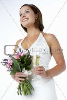 Portrait Of Bride Holding Bouquet And Wine Glass