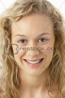 Portrait Of Young Woman Smiling At The Camera