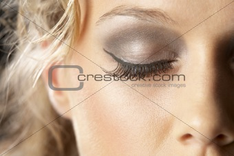 Extreme Close-Up Of Young Woman With Glamorous Make-Up