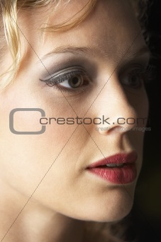 Young Woman Wearing Make-Up, Looking Thoughtful