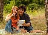 Two students at outdoor doing homework.