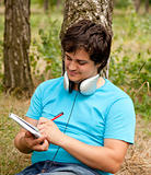 Student with notebook and headphones.