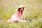 Retro style girl at countryside with notebook.