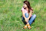 Happy girl at green grass.