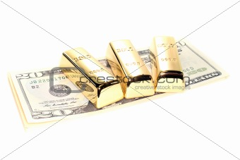 three gold bars on dollar bills