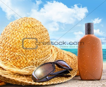 Beach items and suntan lotion at the beach